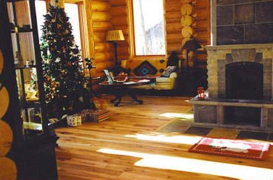 This cabin's exquisite hickory main floor covers roughly 1500 square feet.