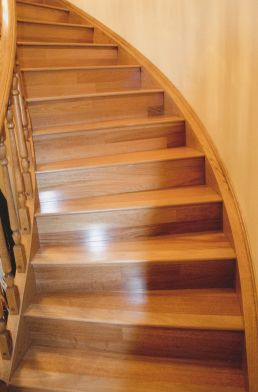 At level – hardwood makes the most of a graceful curved staircase